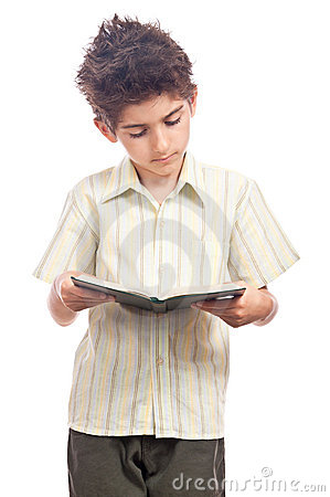 Boy reading a book isolated on white