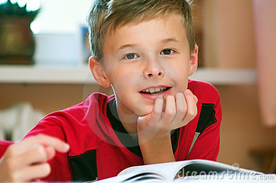 Boy reading book portrait