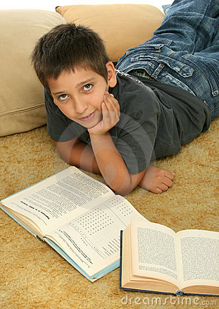Boy reading  books on the floor
