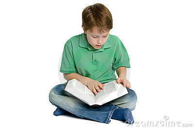 Boy reading crossed legs