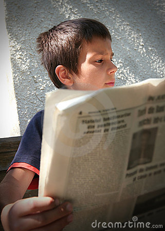Boy Reading the News