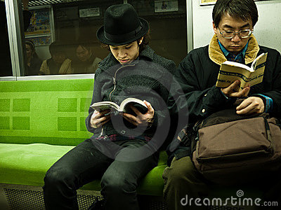 Boy reading in subway Editorial Image