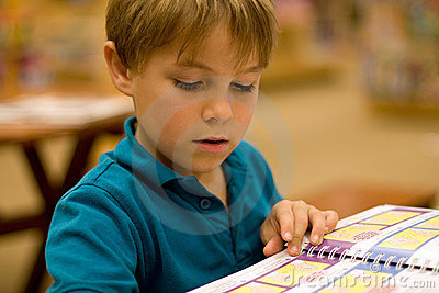 Boy reads a book at libary
