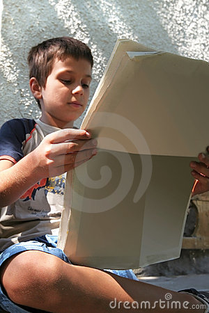 Boy Reads the Morning News