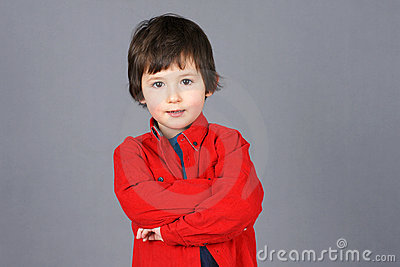 Boy in red with crossed arms