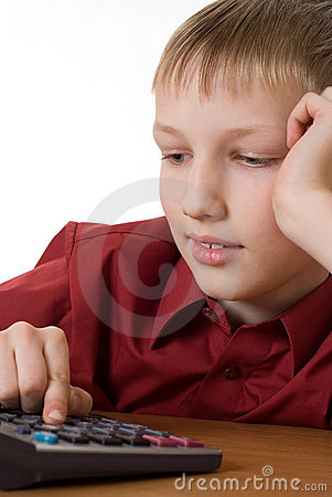 Boy in a red shirt  thinks on the calculator