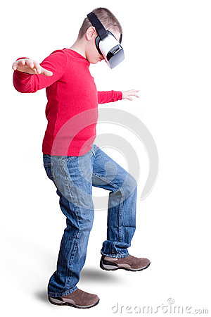 Boy in red shirt with virtual reality glasses Stock Photo