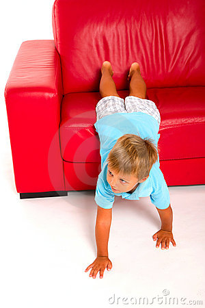 Boy on red sofa