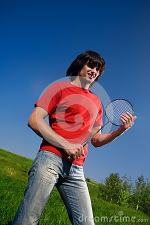 Boy in red t-shirt with racket