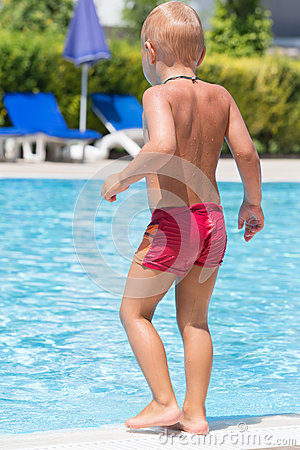 Boy in the red trunks is going to dive