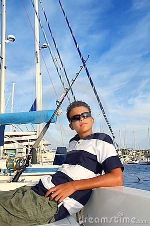 Boy relaxed teenager on boat in vacation