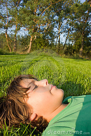 Boy relaxing on grass