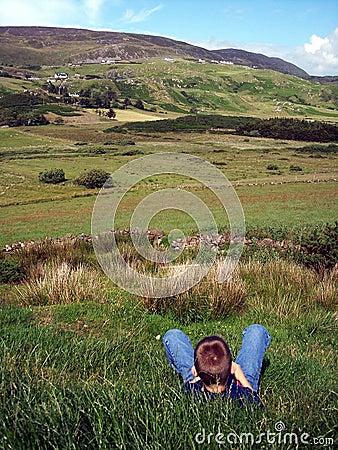 Free Boy Relaxing In Irish Field Stock Photos - 530623