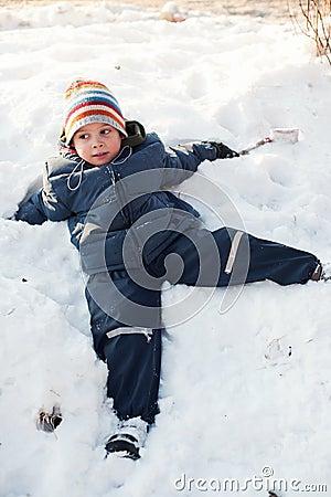 Boy relaxing in snow