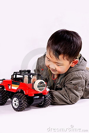 Boy and remote control car