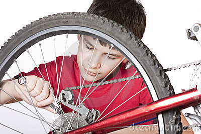 Boy repairing the bicycle