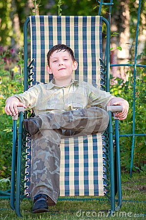 Boy is resting in a deckchair