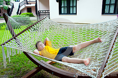 Boy resting in  hammock