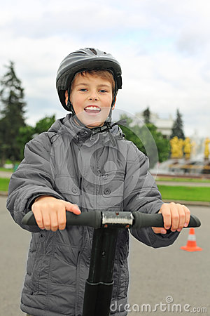 Boy ride on segway near friendship fountain