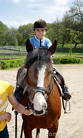 Free Boy Rides On A Horse Royalty Free Stock Photos - 5294968