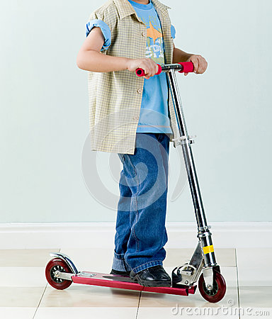 Boy rides a scooter for fun and exercise