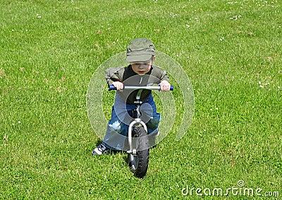 Boy ridig a bike.