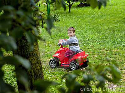 Boy riding atv toy