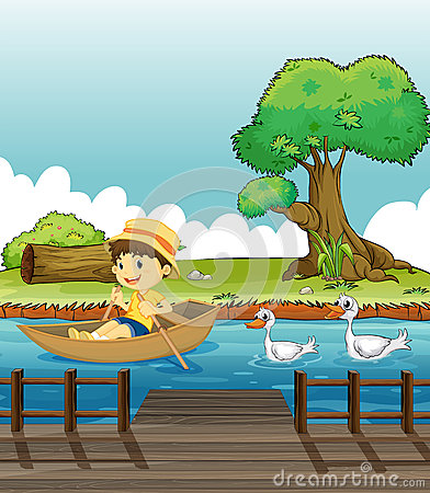 A boy riding on a boat followed by ducks