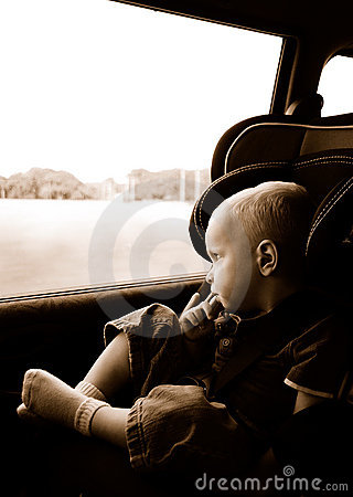 Boy riding in carseat