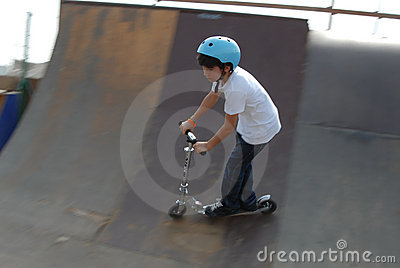 Boy riding his Scooter