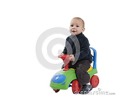Boy riding his toy car