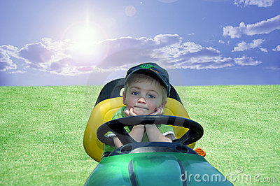 BOY ON A RIDING MOWER RESTING