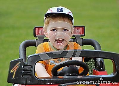 Boy riding racing car