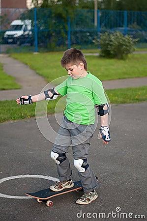 Boy riding a skateboard