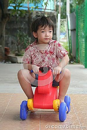 Boy riding on toy horse