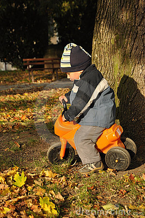 Boy riding toy motorcycle