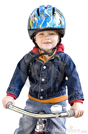 Boy riding tricycle