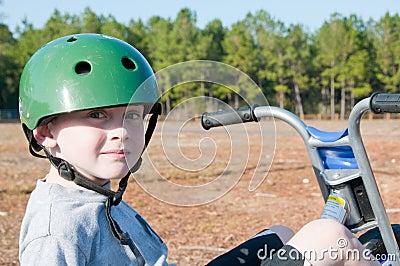 Boy riding trike