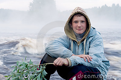 Boy on river bank