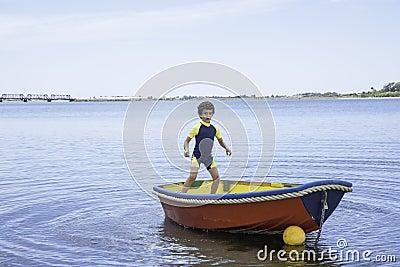 Boy rocking small boat