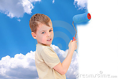 Boy with roller draws sky with clouds