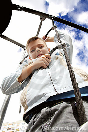 Boy on rope ladder