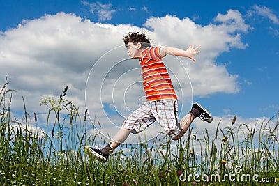 Boy running, jumping outdoor