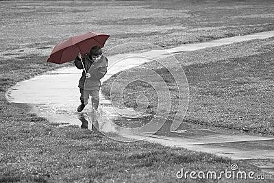 Boy running in the rain