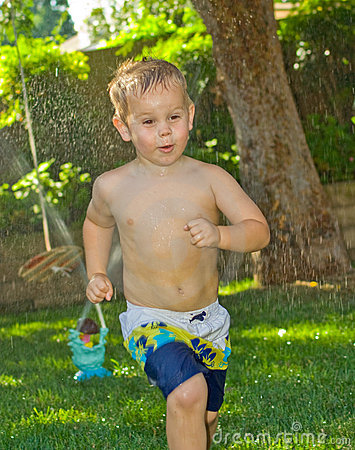 Boy Running in the Sprinklers