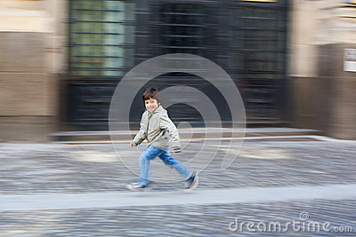 Boy running on street