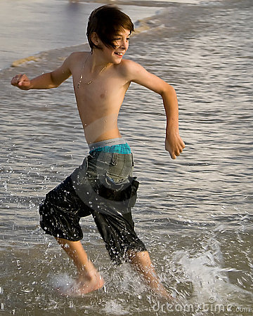 Boy Running with Tide