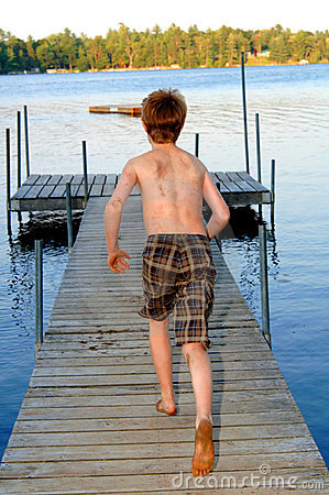 Boy running to the lake