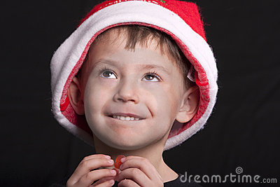 Boy in Santa Claus hat