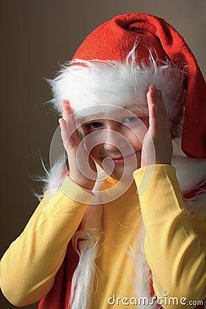 Boy in Santa Claus suit open face.